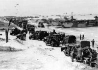 Allied forces equipment come ashore.